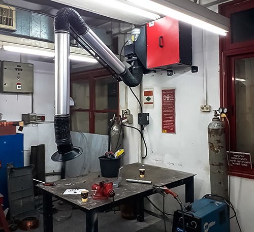 Stationary system for extraction and filtering welding smoke